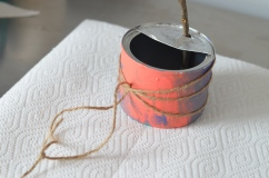 recycled bird feeder with twine wrapped around