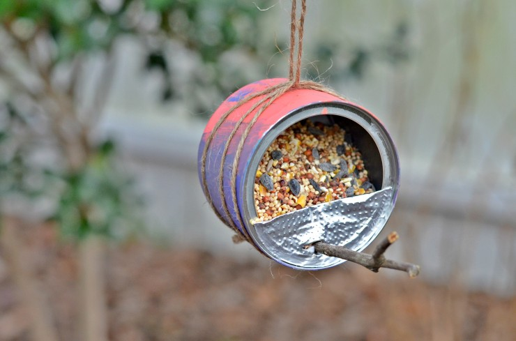 bird feeder made from recycled can and stick