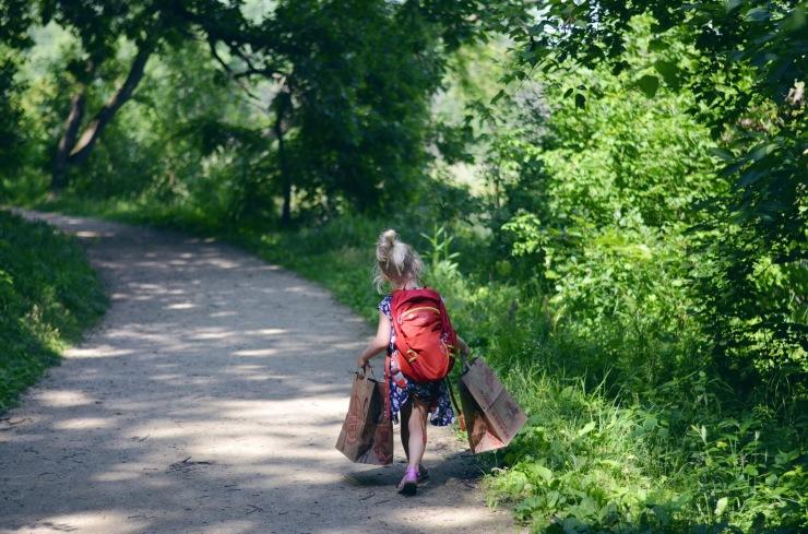Girl walking on trail