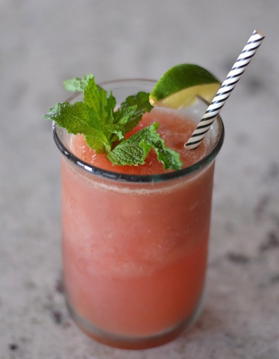 watermelon slush with lime wedge and mint