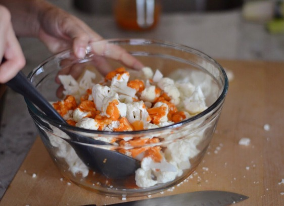 cauliflower with buffalo sauce in a bowl