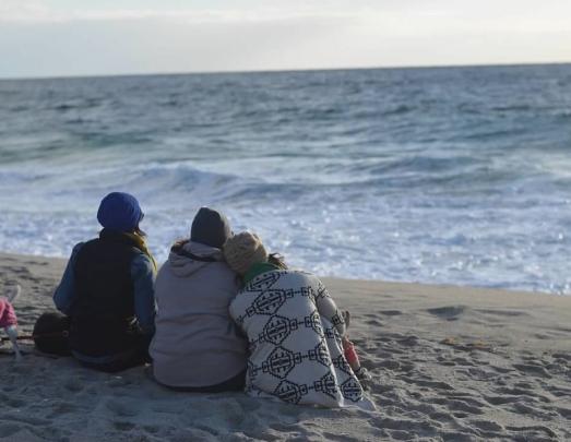 three ladies on the beach