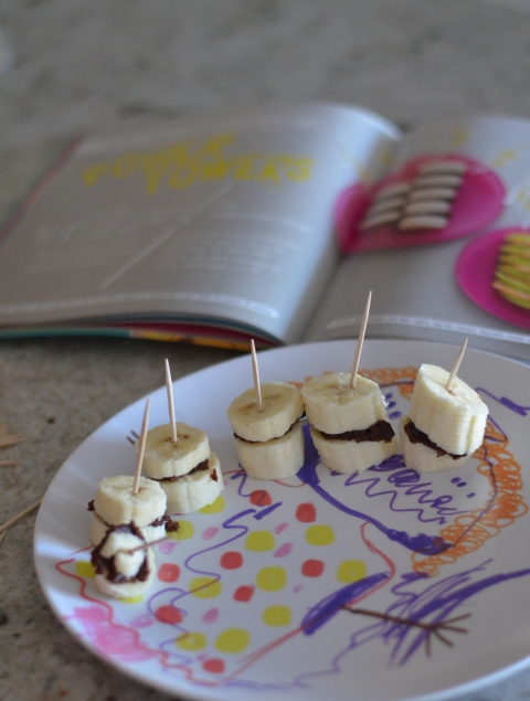 bananas with chocolate almond butter on childs plate