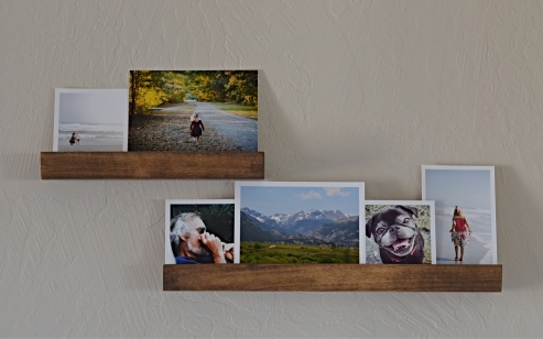 wood photo ledge with photos